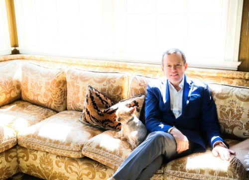 Alex Papachristidis with his Yorkie Teddy whose paws only touch the ground when the grass is perfect - toxin free for a naturally-nutured garden. Photo by D. Newman)