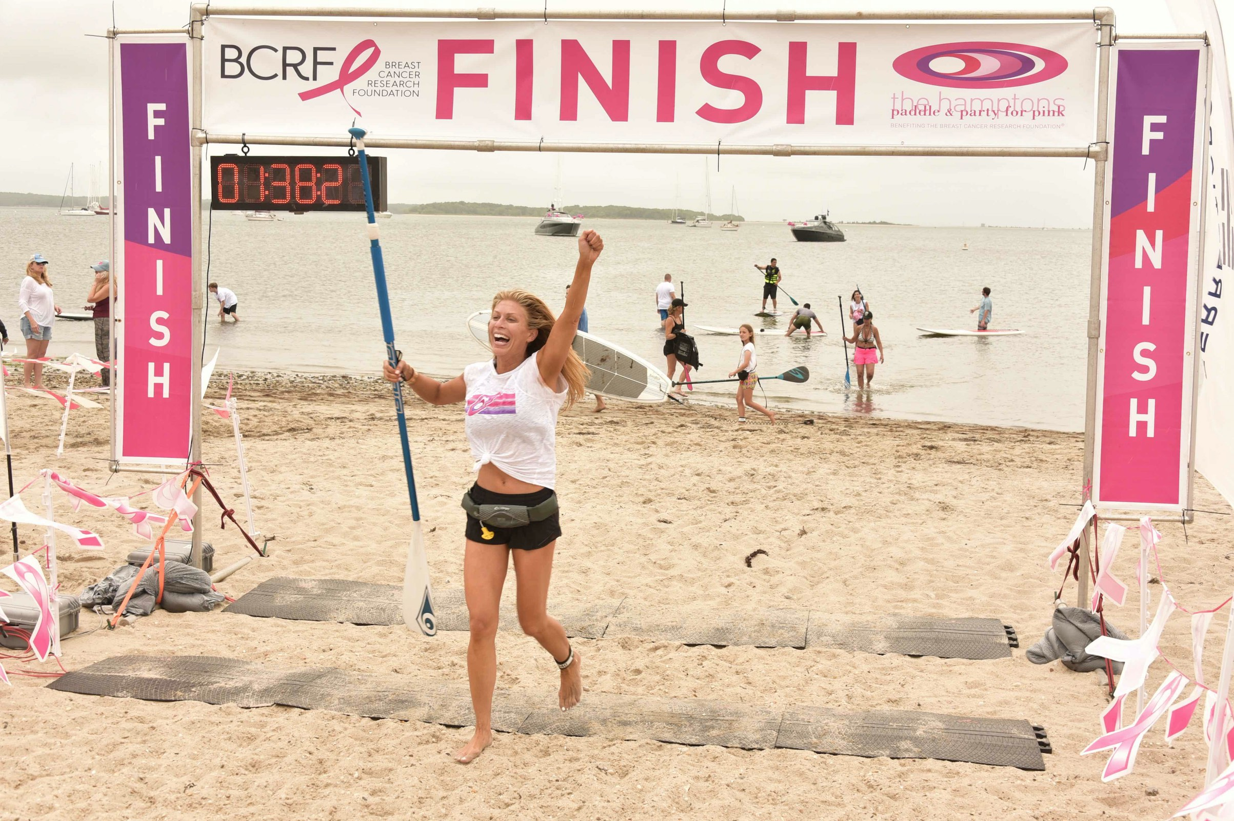 Jill Martin crossing finish line - Photo by: Rob Rich